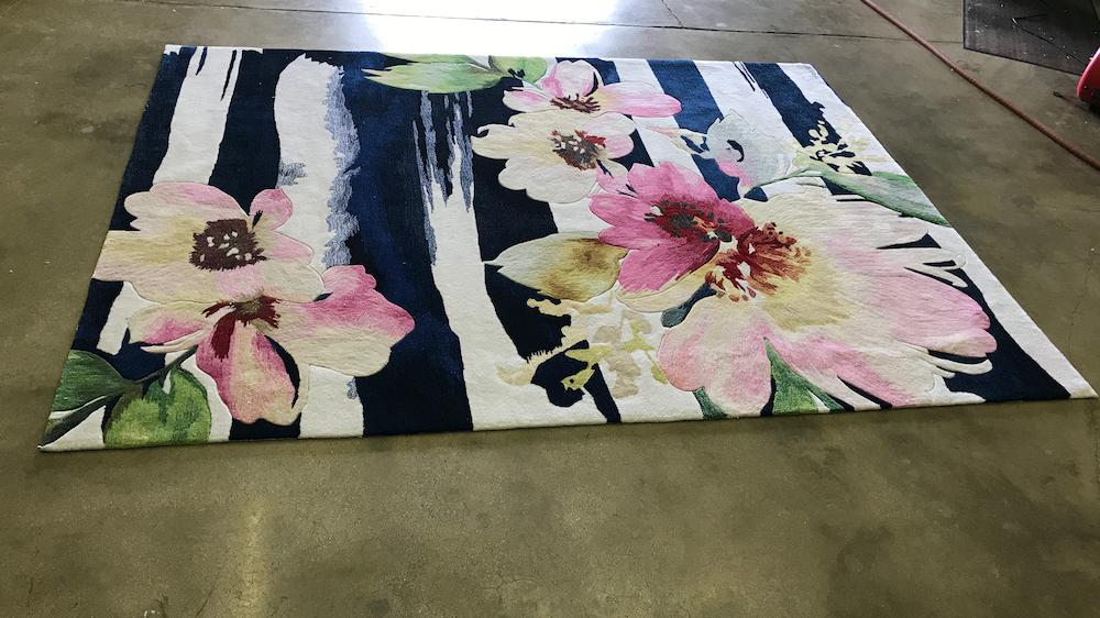 downsizing area rug before