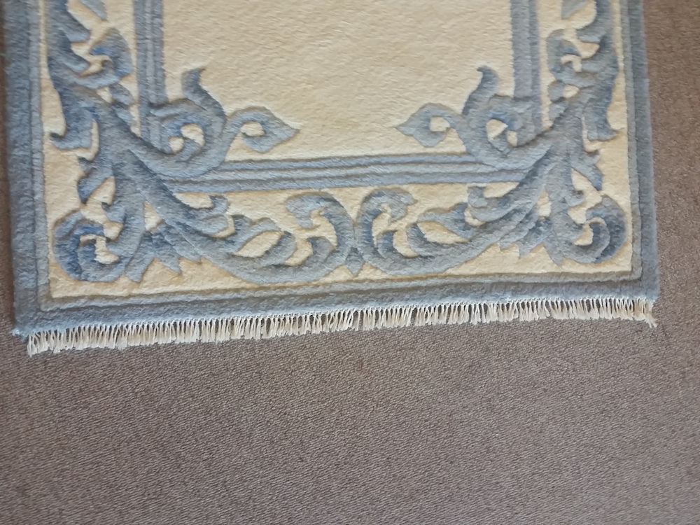 fringe repair on area rug after